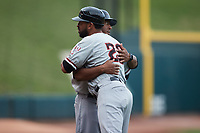 Hickory Crawdads manager Josh Johnson (right) gives a hug to development coach Hiram Bocachica (28) prior to the game against the Winston-Salem Dash at Truist Stadium on July 7, 2021 in Winston-Salem, North Carolina. (Brian Westerholt/Four Seam Images)