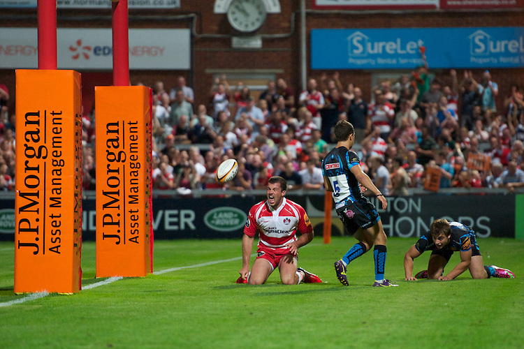 20130801 Copyright onEdition 2013 ©<br />Free for editorial use image, please credit: onEdition.<br /><br />Gareth Evans of Gloucester Rugby 7s shows his delight at scoring a try during the J.P. Morgan Asset Management Premiership Rugby 7s Series.<br /><br />The J.P. Morgan Asset Management Premiership Rugby 7s Series kicks off for the fourth season on Thursday 1st August with Pool A at Kingsholm, Gloucester with Pool B being played at Franklin's Gardens, Northampton on Friday 2nd August, Pool C at Allianz Park, Saracens home ground, on Saturday 3rd August and the Final being played at The Recreation Ground, Bath on Friday 9th August. The innovative tournament, which involves all 12 Premiership Rugby clubs, offers a fantastic platform for some of the country's finest young athletes to be exposed to the excitement, pressures and skills required to compete at an elite level.<br /><br />The 12 Premiership Rugby clubs are divided into three groups for the tournament, with the winner and runner up of each regional event going through to the Final. There are six games each evening, with each match consisting of two 7 minute halves with a 2 minute break at half time.<br /><br />For additional images please go to: http://www.w-w-i.com/jp_morgan_premiership_sevens/<br /><br />For press contacts contact: Beth Begg at brandRapport on D: +44 (0)20 7932 5813 M: +44 (0)7900 88231 E: BBegg@brand-rapport.com<br /><br />If you require a higher resolution image or you have any other onEdition photographic enquiries, please contact onEdition on 0845 900 2 900 or email info@onEdition.com<br />This image is copyright the onEdition 2013©.<br /><br />This image has been supplied by onEdition and must be credited onEdition. The author is asserting his full Moral rights in relation to the publication of this image. Rights for onward transmission of any image or file is not granted or implied. Changing or deleting Copyright information is illegal as specified in the Copyright, Design and Pat