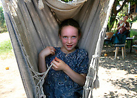 VC.12tribes.1.0903.jl.jpg/photo Jamie Scott Lytle/Seven year old Marbiyth Ostrom sits in a hammock under a shady tree after lunch Thursday on a hot summers day in Valley Center