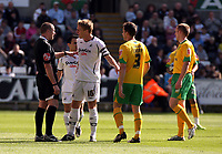ATTENTION SPORTS PICTURE DESK<br /> Pictured: Garry Monk of Swansea (3rd L) is protesting to match referee G Salisbury (L) for his yellow car to Leon Britton of Swansea (2nd L)<br /> Re: Coca Cola Championship, Swansea City FC v Norwich City FC at the Liberty Stadium Swansea, south Wales. Saturday 11 April 2009.<br /> Picture by D Legakis Photography / Athena Picture Agency, Swansea 07815441513