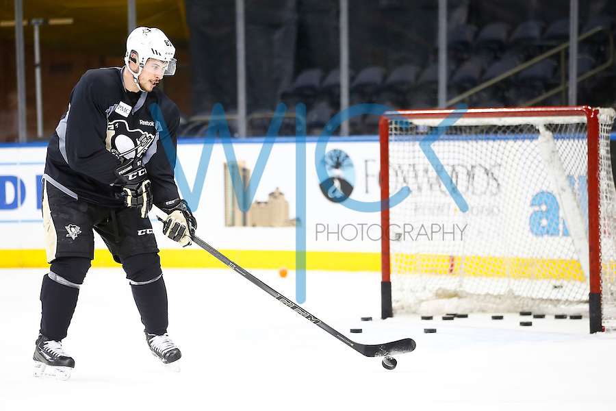 Sidney Crosby #87 of the Pittsburgh Penguins redirects pucks during practice at Madison Square Garden in New York City on April 20, 2016. (Photo by Jared Wickerham / DKPS)