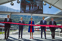 "Switzerland. Canton Ticino. Camorino. Ceneri Base Tunnel (CBT). Official opening ceremony. (Left to right) Dieter Schwank (CEO Alptransit Gothard AG), Federal Councillor Ignazio Cassis, Swiss President Simonetta Sommaruga, Norman Gobbi (Ticino State Councilor), Vincent Ducrot (CEO CFF FFS SBB). Swiss President Simonetta Sommaruga cuts the red ribbon. The Ceneri Base Tunnel (CBT) (Italian: Galleria di base del Monte Ceneri) is a railway base tunnel in Canton Ticino. It passes under Monte Ceneri between Camorino in the Magadino Flat and Vezia near Lugano, and bypasses the former high-altitude rail route through the Monte Ceneri Tunnel. It is composed of two single-track tunnels, each 15.4 km long. It is another part of the New Railway Link through the Alps (NRLA) project. The impact will be significant on international traffic with shorter time trips. The opening of the Ceneri tunnel also means a transport revolution for the southern canton of Ticino. Regional rail lines will be upgraded, and some reckon the change could lead to the creation of a ""Ticino City"" – one big urban sprawl across the canton. 4.09.2020  © 2020 Didier Ruef"