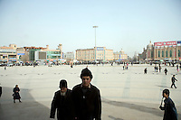 The Id Kah Mosque, and surrounding plaza, in Kashgar, Xinjiang, China, serve as the spiritual center of the Uighur minority.  In recent years, the local government has retiled the square and removed tiles that indicate the direction of Mecca.