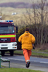 Search and Rescue personel running to the scene of the Mid air collision over Kenfig sand dunes near Porthcawl..