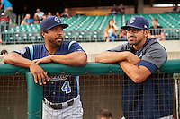 Corpus Christi Hooks Brandon Meredith (4) and Jiovanni Mier (5) in the dugout before a game against the Arkansas Travelers on May 29, 2015 at Dickey-Stephens Park in Little Rock, Arkansas.  Corpus Christi defeated Arkansas 4-0 in a rain shortened game.  (Mike Janes/Four Seam Images)