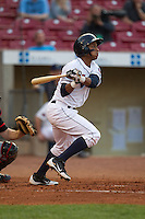 Cedar Rapids Kernels designated hitter Jorge Polano #5 bats during a game against the Lansing Lugnuts at Veterans Memorial Stadium on April 29, 2013 in Cedar Rapids, Iowa. (Brace Hemmelgarn/Four Seam Images)