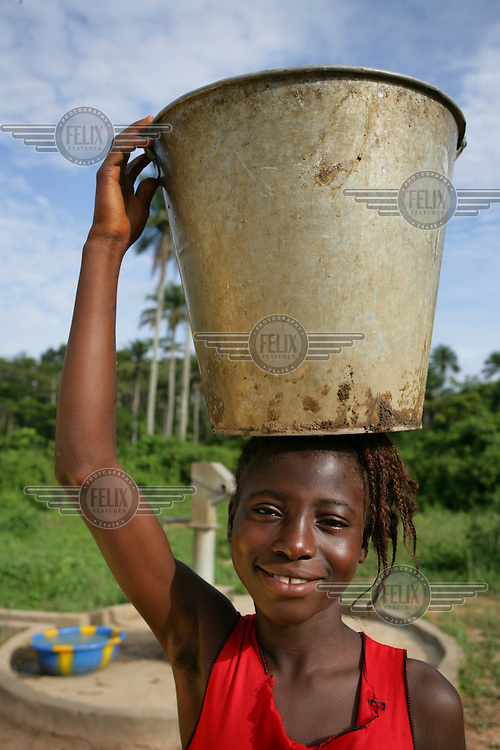 A girl collecting water from the water point at the school in Selega Village.