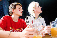 Germany fans watch their team play Costa Rica at Zum Schneider's, a German beer hall in New York City on June 9, 2006.  <br /> <br /> The World Cup, held every four years in different locales, is the world's pre-eminent sports tournament in the world's most popular sport, soccer (or football, as most of the world calls it).  Qualification for the World Cup is open to any country with a national team accredited by FIFA, world soccer's governing body. The first World Cup, organized by FIFA in response to the popularity of the first Olympic Games' soccer tournaments, was held in 1930 in Uruguay and was participated in by 13 nations.    <br /> <br /> As of 2010 there are 208 such teams.  The final field of the World Cup is narrowed down to 32 national teams in the three years preceding the tournament, with each region of the world allotted a specific number of spots.  <br /> <br /> The World Cup is the most widely regularly watched event in the world, with soccer teams being a source of national pride.  In most nations, the whole country is at a standstill when their team is playing in the tournament, everyone's eyes glued to their televisions or their ears to the radio, to see if their team will prevail.  While the United States in general is a conspicuous exception to the grip of World Cup fever there is one city that is a rather large exception to that rule.  In New York City, the most diverse city in a nation of immigrants, the melting pot that is America is on full display as fans of all nations gather in all possible venues to watch their teams and celebrate where they have come from.