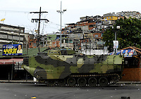 A Brazilian Navy armoured vehicle participates at a military operation in Vila da Penha slum, Rio de Janeiro, Brazil, November 25, 2010. Authorities in Rio de Janeiro try to control a fourth day of violence apparently orchestrated by drug gang members who have attacked police stations and burned cars in Rio de Janeiro city as protest by traffickers after being forced from their turf by police occupations of more than a dozen slums in the past two years..(Austral Foto/Renzo Gostoli)