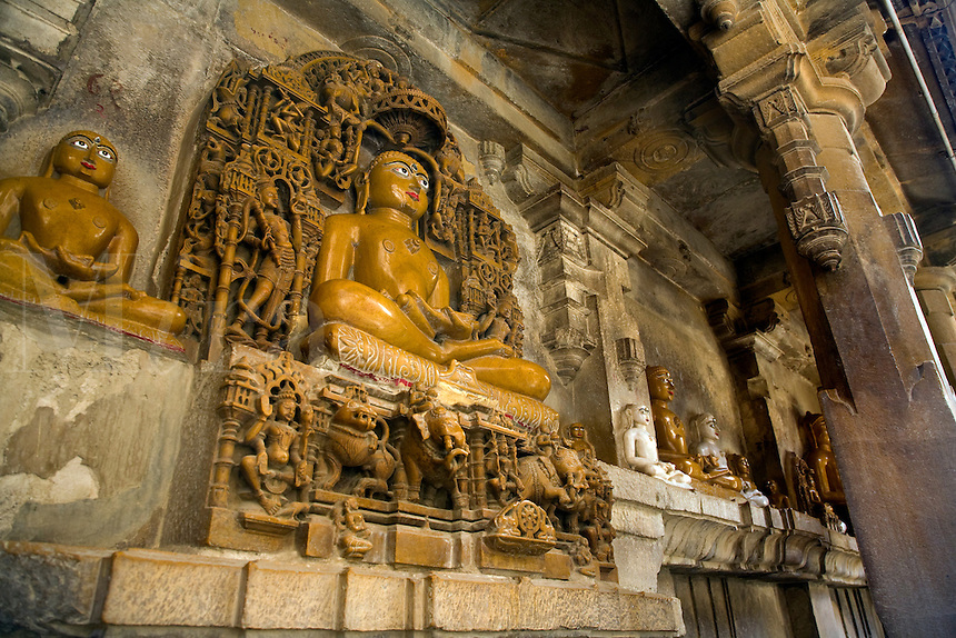 """Hand carved SANDSTONE statues of MAHARIVA and other """"Buddhas"""" in the  CHANDRAPRABHU JAIN TEMPLE inside JAISALMER FORT - RAJASTHAN, INDIA"""