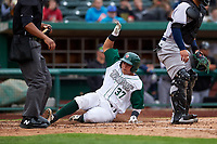 Fort Wayne TinCaps catcher Juan Fernandez (37) slides across home plate during a Midwest League game against the Kane County Cougars at Parkview Field on May 1, 2019 in Fort Wayne, Indiana. Fort Wayne defeated Kane County 10-4. (Zachary Lucy/Four Seam Images)