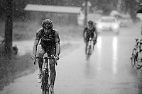 Daniel Oss (ITA/BMC) arriving at the team bus in a rain storm after finishing the stage<br /> <br /> stage 17: Digne-les-Bains - Pra Loup (161km)<br /> 2015 Tour de France