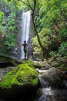 A woman enjoys the view at Uluwehi Falls, Kaua'i.