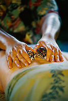 Woman recieving Hawaiian shell treatment at the Mauna Lani spa on the Big Island of Hawaii