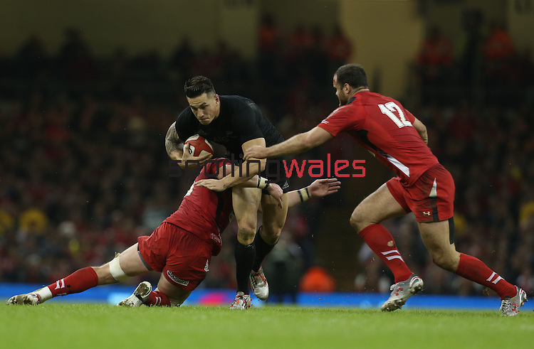 Wales flanker Dan Lydiate tackles All Blacks centre Sonny Bill Williams as Jamie Roberts comes in to support.<br /> Dove men Series 2014<br /> Wales v New Zealand<br /> 22.11.14<br /> ©Steve Pope -SPORTINGWALES