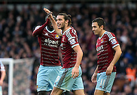 Sunday 07 December 2014<br /> Pictured: Andy Carroll (C) of West Ham is celebratingf his second goal<br /> Re: Premier League West Ham United v Swansea City FC at Boleyn Ground, London, UK.