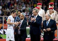 Abby Wambach, Sunil Gulati, Steffi Jones, Sepp Blatter.  Japan won the FIFA Women's World Cup on penalty kicks after tying the United States, 2-2, in extra time at FIFA Women's World Cup Stadium in Frankfurt Germany.