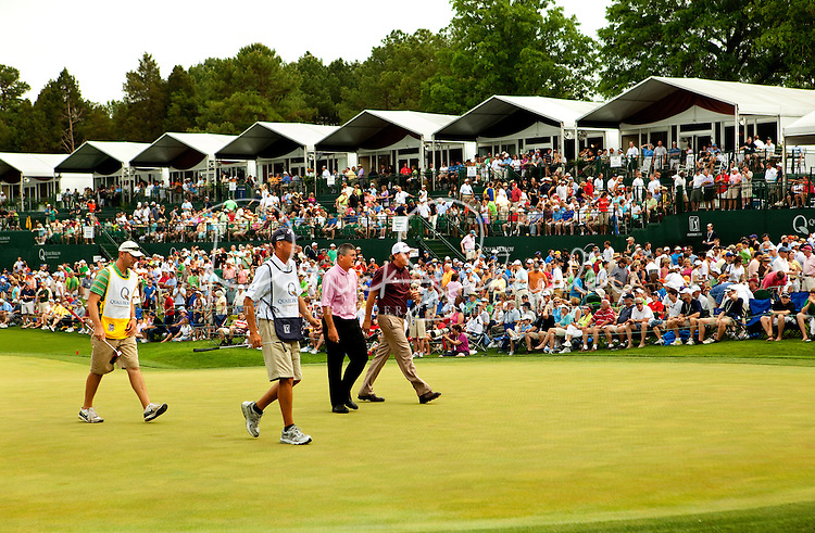 Phil Mickelson (right) during the thirdround of the Quail Hollow Championship at Quail Hollow Country Club on May 2, 2010 in Charlotte, North Carolina.  The event, formerly called the Wachovia Championship, is a top event on the PGA Tour, attracting such popular golf icons as Tiger Woods, Vijay Singh and Bubba Watson. Photo from the final round in the Quail Hollow Championship golf tournament at the Quail Hollow Club in Charlotte, N.C., Sunday , May 03, 2009..