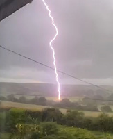 BNPS.co.uk (01202) 558833. <br /> Pic: KateSlater/BNPS<br /> <br /> With video: https://we.tl/t-s3Pw8EFuvb<br /> <br /> This is the shocking moment a bolt of lightning appears to set fire to a field.<br /> <br /> Stunned homeowner Katy Slater recorded the electrical storm pass through the rural village of Stourpaine, Dorset, when the finger of lightning made contact with the ground.<br /> <br /> As it did, an orange ball of flame flashed up from the grassy field but died down almost immediately.