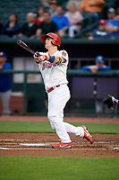 Memphis Redbirds catcher Carson Kelly (19) follows through on a swing during a game against the Round Rock Express on April 28, 2017 at AutoZone Park in Memphis, Tennessee.  Memphis defeated Round Rock 9-1.  (Mike Janes/Four Seam Images)