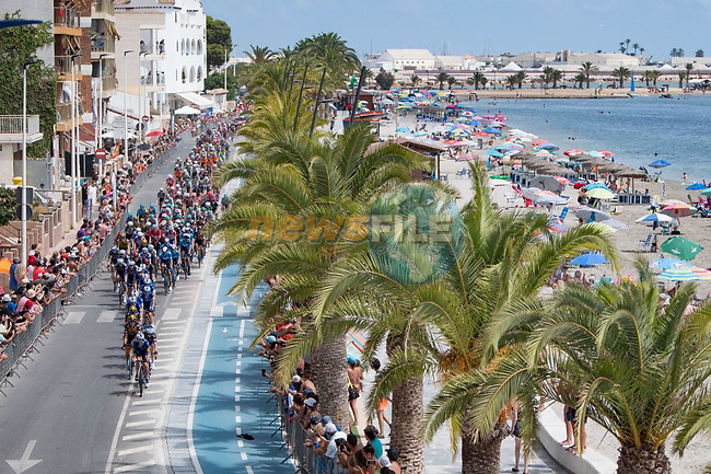 The peloton pass Playa de Villananitos during Stage 8 of La Vuelta d'Espana 2021, running 173.7km from Santa Pola to La Manga del Mar Menor, Spain. 21st August 2021.     <br /> Picture: Cxcling   Cyclefile<br /> <br /> All photos usage must carry mandatory copyright credit (© Cyclefile   Cxcling)