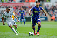 SWANSEA, WALES - MAY 17:  Sergio Aguero of Manchester City  moves the ball forwards during the Premier League match between Swansea City and Manchester City at The Liberty Stadium on May 17, 2015 in Swansea, Wales.  (photo by Athena Pictures)