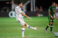 LAKE BUENA VISTA, FL - AUGUST 11: Joao Moutinho #4 of Orlando City SC kicks the ball during a game between Orlando City SC and Portland Timbers at ESPN Wide World of Sports on August 11, 2020 in Lake Buena Vista, Florida.