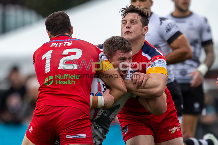 Picture by Kevin Sousa/SWpix.com - 07/10/2018 - Rugby League - Betfred Super League - The Qualifiers - Million Pound Game - Toronto Wolfpack v London Broncos - Lamport Stadium, Toronto, Canada - Jake Emmitt of the Toronto Wolfpack is tackled by Jay Pitts of the London Broncos.