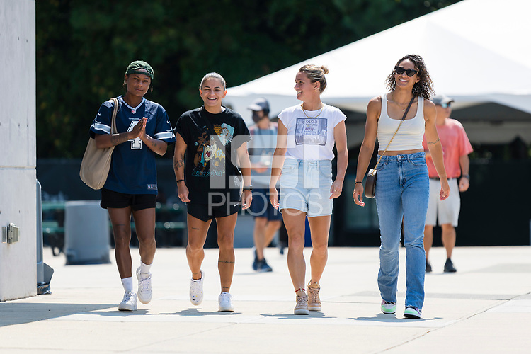 CARY, NC - SEPTEMBER 12: Taylor Smith #2, Debinha #10, Meredith Speck #25, and Lynn Williams #9 of the NC Courage arrive at Sahlen's Stadium before a game between Portland Thorns FC and North Carolina Courage at WakeMed Soccer Park on September 12, 2021 in Cary, North Carolina.
