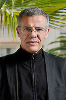 Abdellatif Kechiche, director of 'Blue is the Warmest Colour' ['La vie d'Adèle'], poses for the photographer during the Cannnes Film Festival, Cannes, France, 24 May 2013