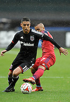 Washington, D.C.- March 29, 2014. Luis Silva (11) of D.C. United goes against Alex of the Chicago Fire.  The Chicago Fire tied D.C. United 2-2 during a Major League Soccer Match for the 2014 season at RFK Stadium.