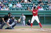 Shortstop Christian Koss (8) of the Greenville Drive in a game against the Asheville Tourists on Sunday, September 5, 2021, at Fluor Field at the West End in Greenville, South Carolina. The catcher is C.J. Stubbs (15) and the umpire is Willie Traynor. (Tom Priddy/Four Seam Images)