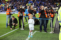 Liverpool, UK. Saturday 01 November 2014<br /> Pictured: A young Swansea mascot stands looking embarassed infront of match photographers.<br /> Re: Premier League Everton v Swansea City FC at Goodison Park, Liverpool, Merseyside, UK.
