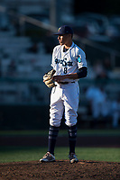Everett AquaSox relief pitcher Jorge Benitez (8) gets ready to deliver a pitch during a Northwest League game against the Tri-City Dust Devils at Everett Memorial Stadium on September 3, 2018 in Everett, Washington. The Everett AquaSox defeated the Tri-City Dust Devils by a score of 8-3. (Zachary Lucy/Four Seam Images)