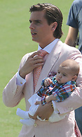 WEST PALM BEACH, FL - MARCH 14: (EXCLUSIVE COVERAGE) Kourtney Kardashian and Scott Disick with their young son Mason Dash Disick in tow take a polo lesson with top ranked american polo player Nic Roldan. The couple was joined by sister Khloe Kardashian. The kardashian clan had a great afternoon, riding horses and joking around while they sipped champagne at the International polo club palm beach on March 14, 2010 in Wellington, Florida.<br /> <br /> <br /> People:  Scott Disick_Mason Dash Disick