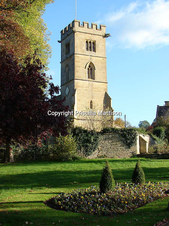 Cotswolds, England - November 1, 2006: St. Michael's Church has a serene setting in a Cotswold village.