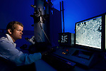 Guido Westhoff looking at a cross section of a  pit organ tissue of a carpet python (Morelia spilota mcdowelli) through an electron microscope with 20,000 x magnification