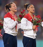 USWNT forwards Lauren Cheney and Natasha Kai sing the national anthem after playing for the gold medal at Workers' Stadium.  The USWNT defeated Brazil, 1-0, during the 2008 Beijing Olympics women's soccer final in Beijing, China.