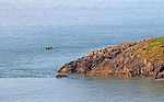 Swansea, UK, 10th May 2020.<br />A couple paddle their kayak around Snaple Point at Langland Bay near Swansea this morning during the stunning May bank holiday weekend weather.