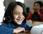 A girl in a preschool for Roma children in the Zemun Polje neighborhood of Belgrade, Serbia. The program, for children 5-9 years old, is part of the Branko Pesic School, supported by Church World Service.  Many of the children are from refugee families that fled from Kosovo. Lacking legal legal status in Serbia, their children are unable to attend regular schools.