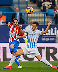 Juanfran (l) of Club Atletico de Madrid fights for the ball with Juan Carlos Perez Lopez 'Juankar' of Malaga CF during their La Liga match between Club Atletico de Madrid and Malaga CF at the Estadio Vicente Calderón on 29 October 2016 in Madrid, Spain. Photo by Diego Gonzalez Souto / Power Sport Images