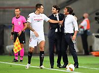 21st August 2020, Rheinenergiestadion, Cologne, Germany; Europa League Cup final Sevilla versus Inter Milan;  Lucas Ocampos of Sevilla FC confronts Antonio Conte, Manager of Inter Milan