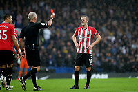 Referee Martin Atkinson shows Southampton's James Ward-Prowse a red card as the Saints captain is sent off during Chelsea vs Southampton, Premier League Football at Stamford Bridge on 2nd October 2021
