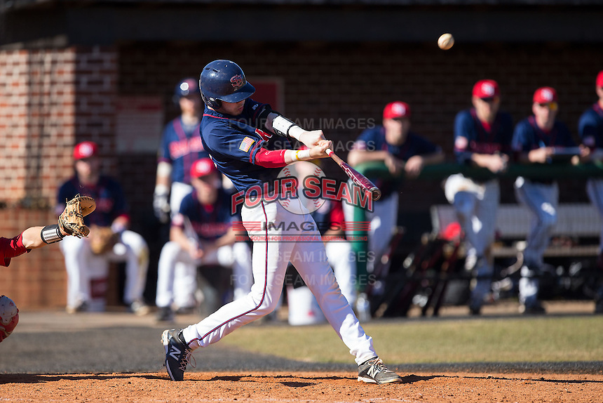 Jake Kennedy (30) of the Shippensburg Raiders connects for his first of two home runs on the day against the Belmont Abbey Crusaders at Abbey Yard on February 8, 2015 in Belmont, North Carolina.  The Raiders defeated the Crusaders 14-0.  (Brian Westerholt/Four Seam Images)