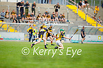 Abbeydorneys Tomás Ó'hAiniféin on a solo run as Tom Doyle of Dr Crokes gives chase in the County Senior hurling championship game on Sunday