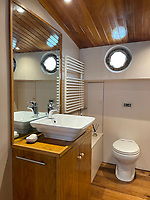 BNPS.co.uk (01202) 558833. <br /> Pic: Zeewarriors/BNPS<br /> <br /> Pictured: Bathroom.<br /> <br /> A 100-year old Dutch sailing barge moored in Bermondsey has gone on sale for £278,000.<br /> <br /> The 25-metre MV Johanna Elisabeth was originally constructed in 1913 at Appelo, Zwartsluis in Holland, and was brought to the UK in 2003 by a previous owner.<br /> <br /> Her work as a sailing barge included shipping freight but she is now moored at the South Dock Marina in Bermondsey, south London, and used as a home.