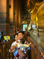 Bangkok, Thailand.  Reclining Buddha, Wat Pho Temple Complex.  Young Family Making a Selfie.