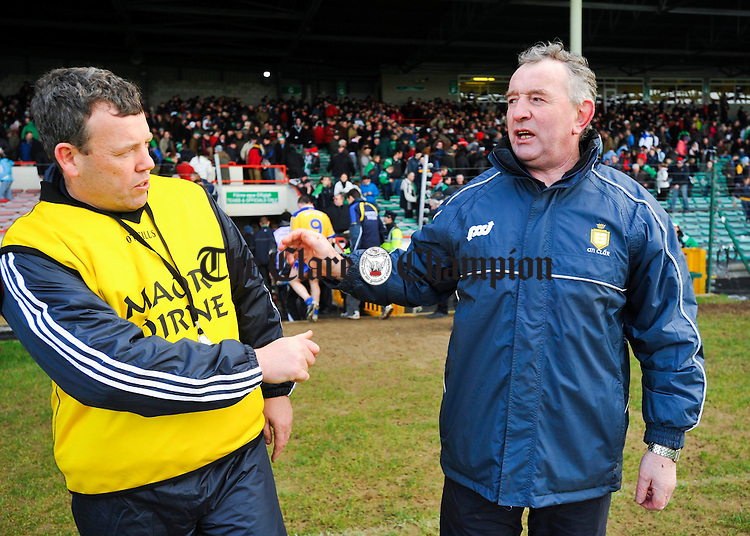 Limerick selector Gary Kirby and Clare's manager Mike Mc Namara meet following  their National League game in Limerick. Photograph by John Kelly.