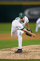 Charlotte 49ers relief pitcher Patrick Szczypinski (25) follows through on his delivery against the Clemson Tigers at BB&T BallPark on March 26, 2019 in Charlotte, North Carolina. The Tigers defeated the 49ers 8-5. (Brian Westerholt/Four Seam Images)