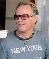 NEW YORK - MARCH 20: Peter Fonda and Portia Rebecca Crockett enjoy some oysters at Pastis, in the Meatpacking district. . on March 20, 2010 in New York, New York City.<br /> <br /> <br /> People:  Peter Fonda and Portia Rebecca